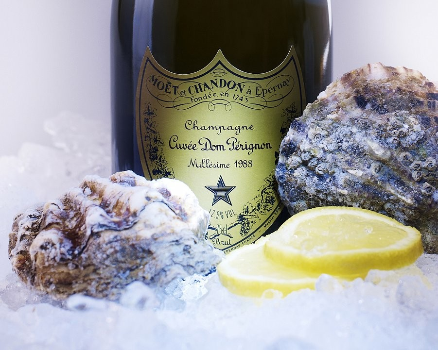 Dom Perignon Champagne and Oysters surrounded by crushed ice