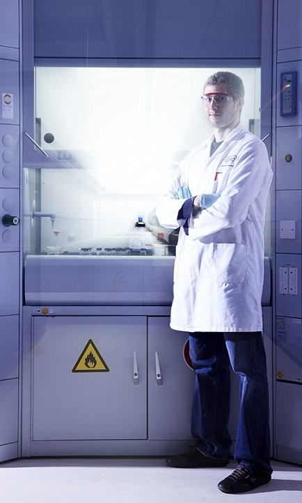 Location shot of laboratory and man in white coat