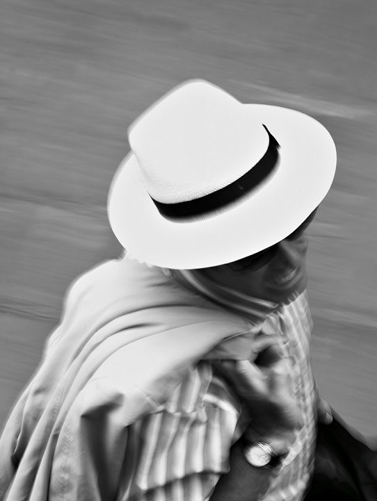 Fashion shot of male model wearing a panama hat and sunglasses