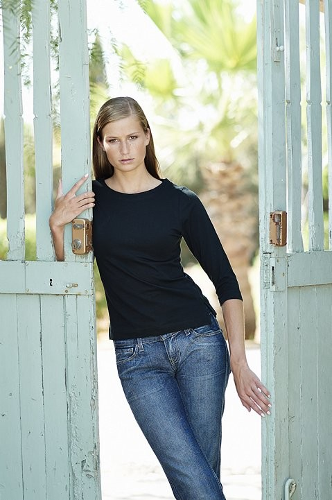 Fashion shoot of model in Spain, wearing jeans.