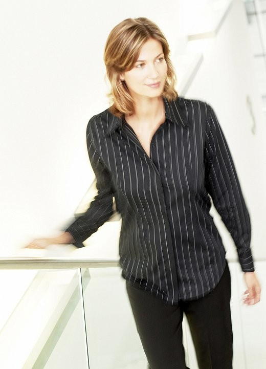 Fashion shoot - model on staircase in business blouse