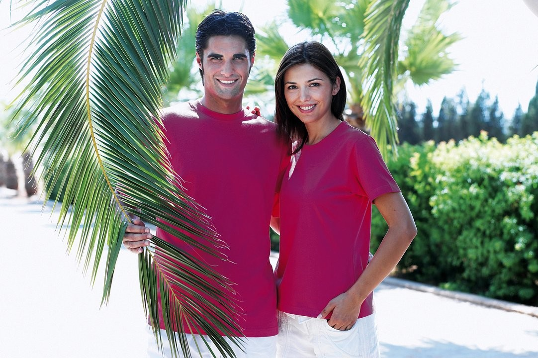 Male and Female models with Palm tree in sunshine