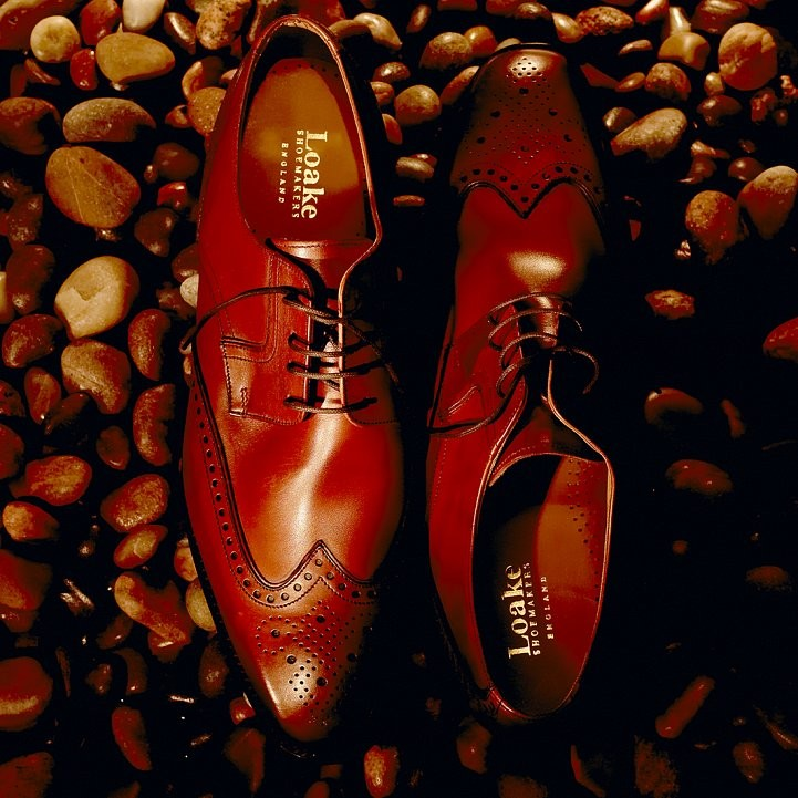 Loake mens shoes shot from above on a pebble background