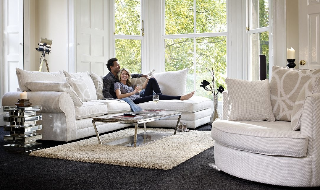 Location shoot for home furniture client with two models on sofa
