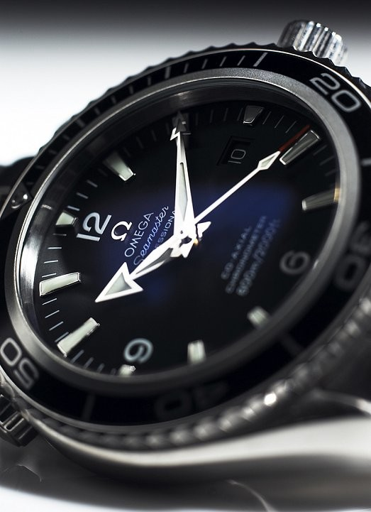 Close up detail shot of Omega Seamaster Planet Ocean watch